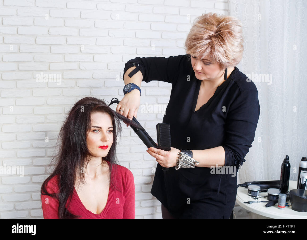 Professional Hairdresser Middle Aged Woman Straightening Long Hair
