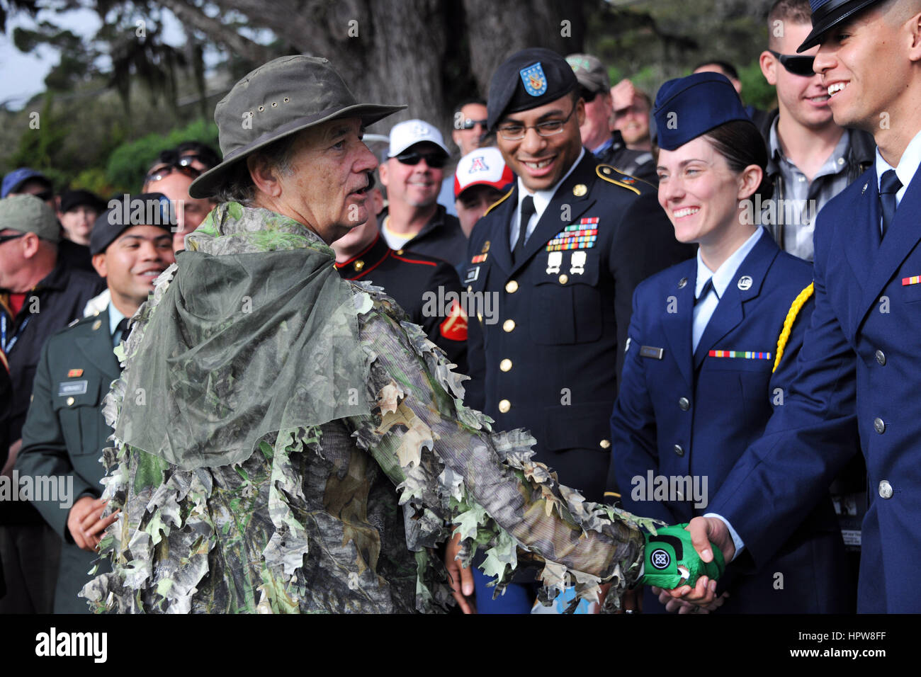 Actor and comedian Bill Murray dressed in a camouflage ghillie suit, greets service members during the AT&T - Stock Image