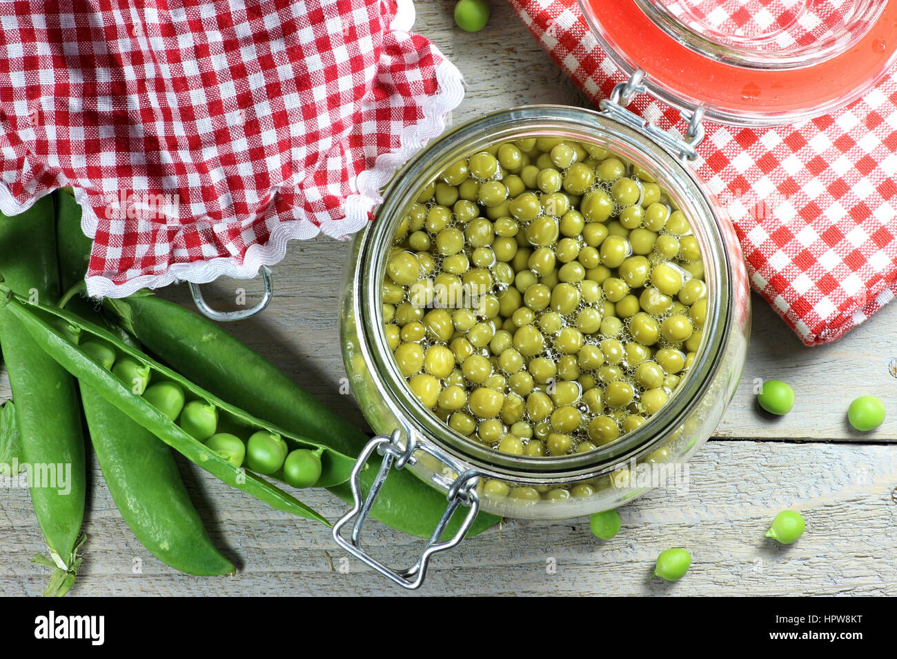 home canned peas on wooden table Stock Photo