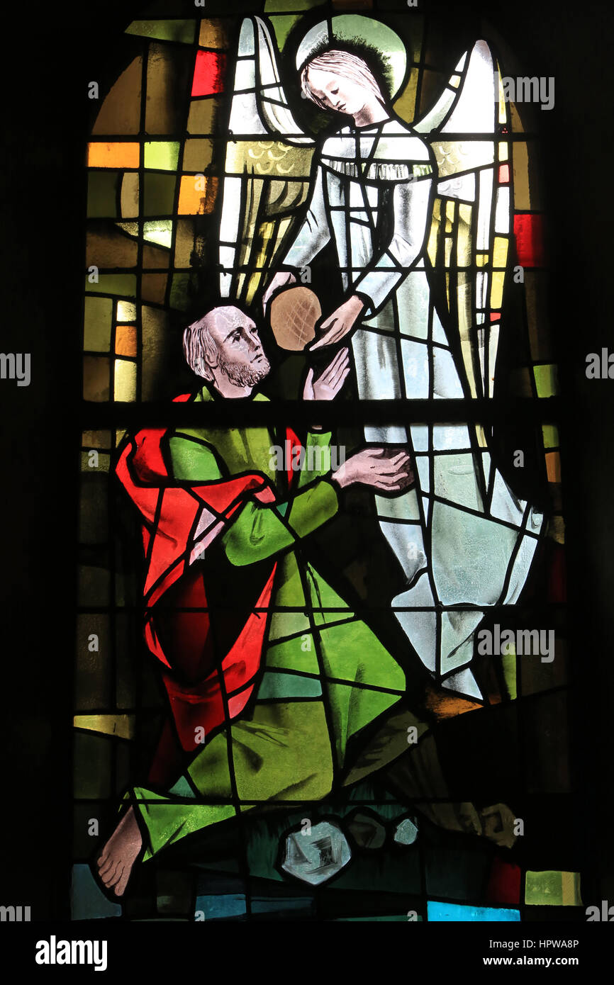 Stained glass made in 1963 by Max Ingrand, in the southern chapel of the Church of St. Ulrich of Altenstadt in Wissembourg. - Stock Image
