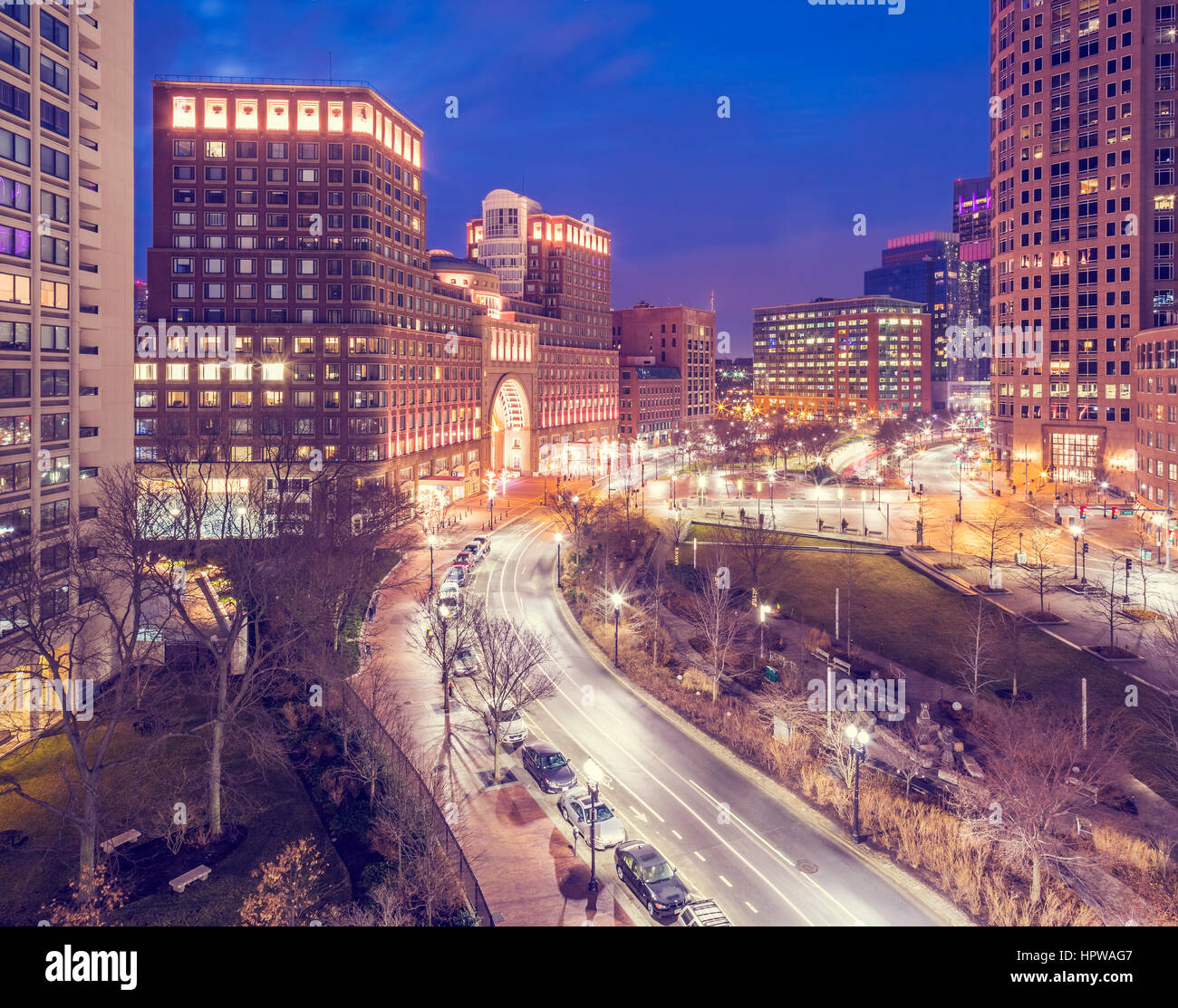 Boston in Massachusetts, USA at night in a cross processed photo. - Stock Image
