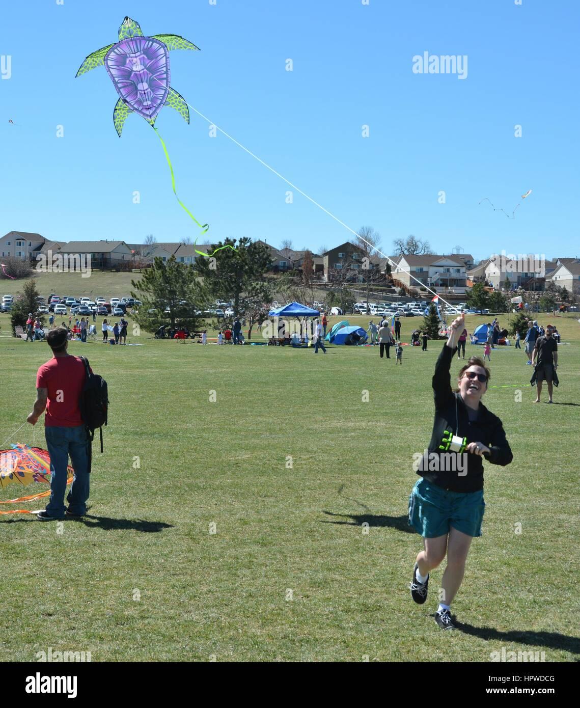 Unidentified People Flying Kites - Stock Image