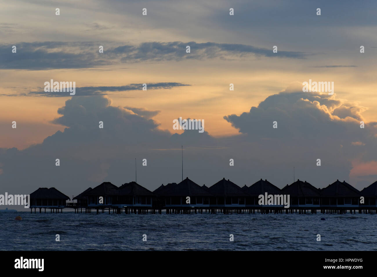 resort with villas on stilts at beach in Bagan Lalang, west coast Malaysia - Stock Image