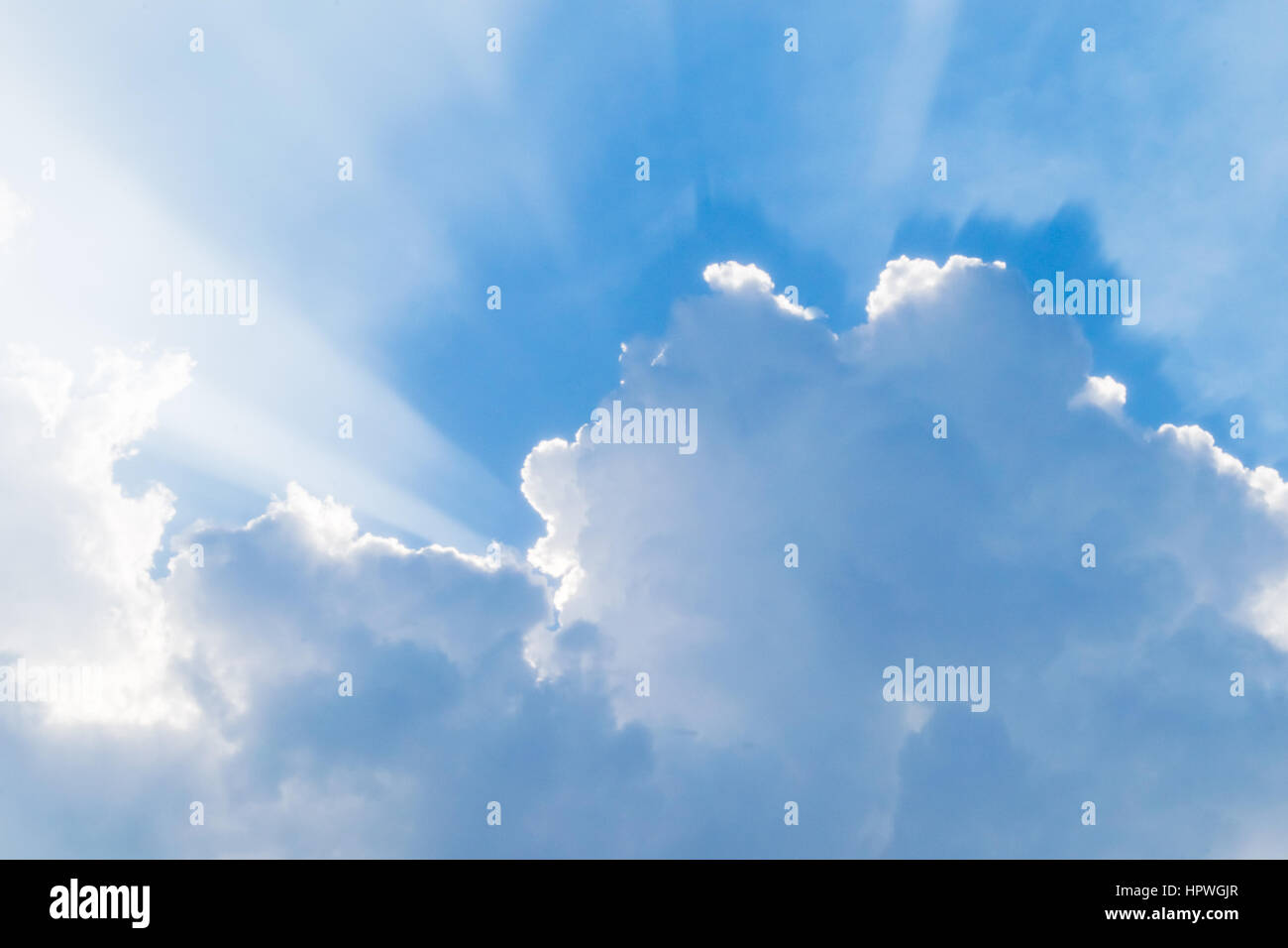 blue sky with rays after raining. Rays appearing with cloud burst - Stock Image