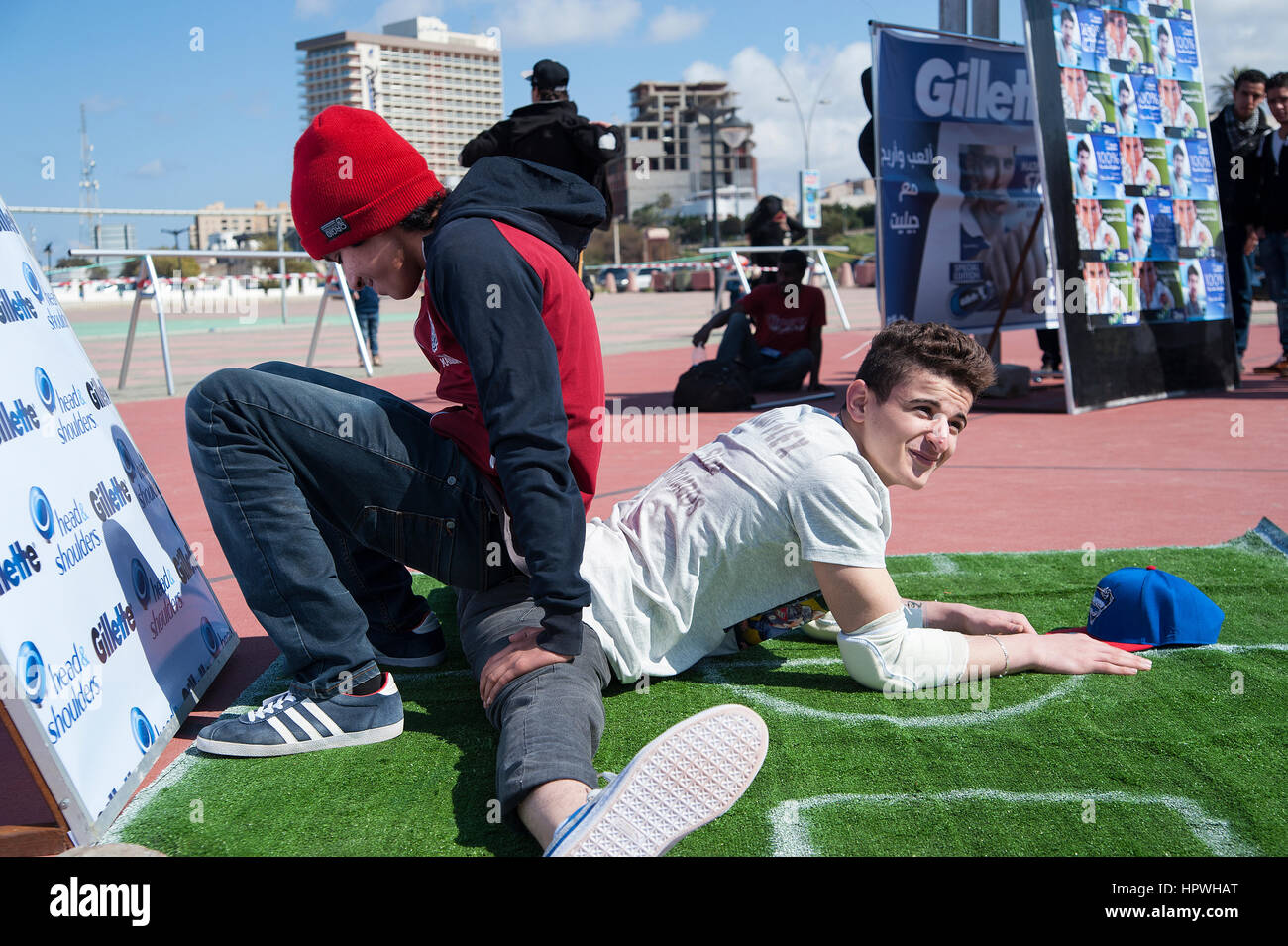 Libya, Tripoli: Young guys breakdance at an open air dance and parkour festival. - Stock Image