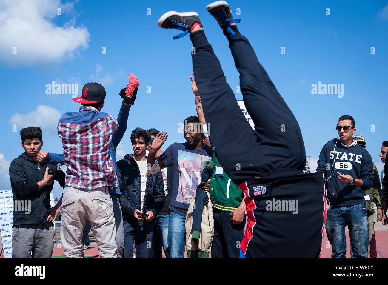 Libya, Tripoli: Young guys breakdance at an open air dance and parkour festival. Stock Photo