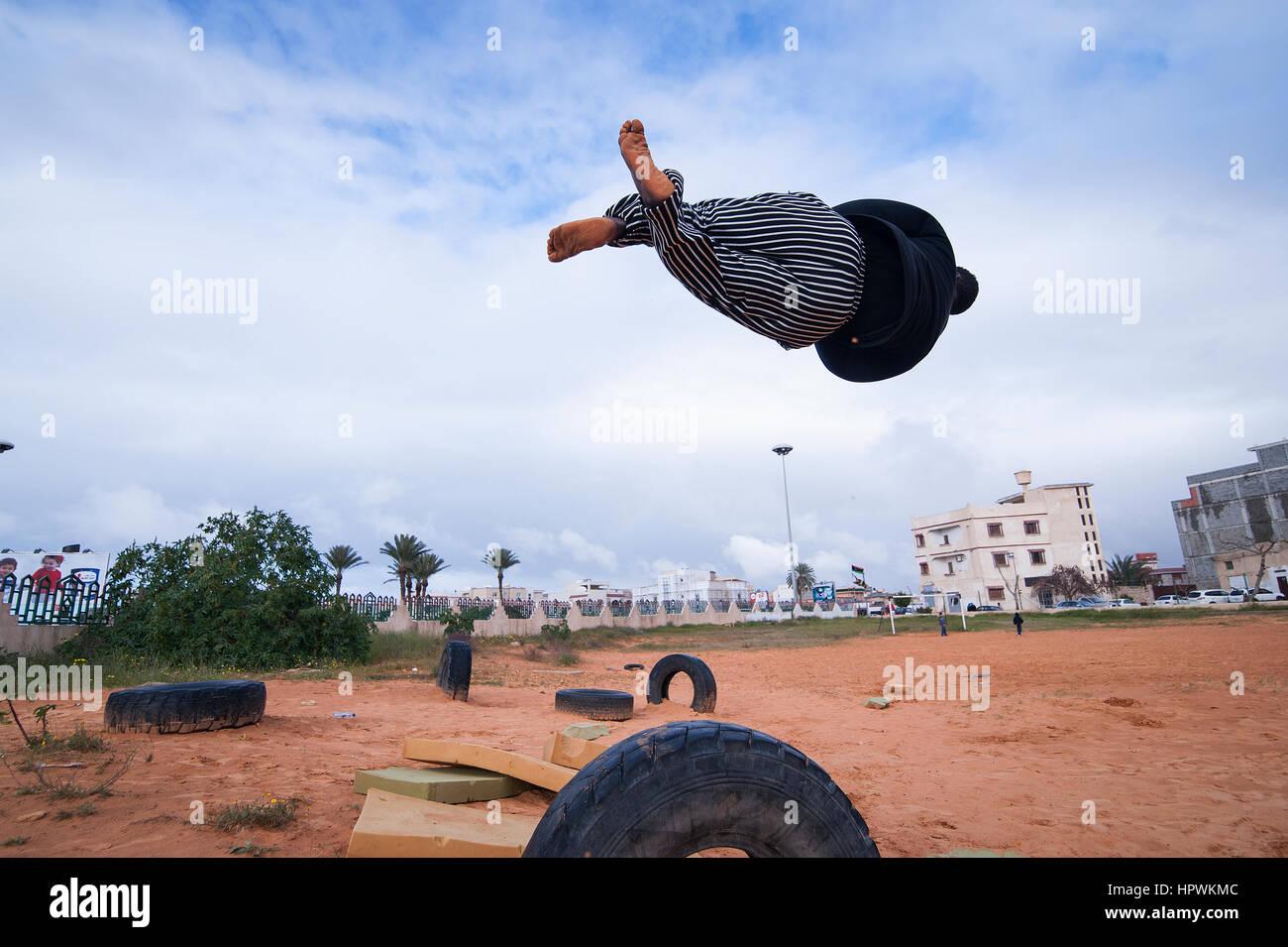 Libya, Tripli: Young guys practising parkour moves. - Stock Image
