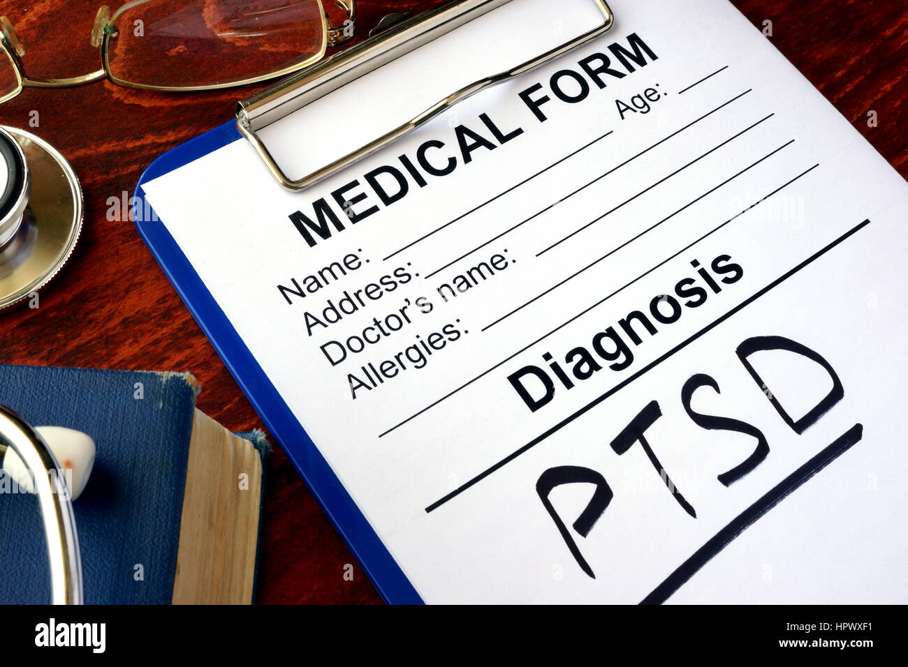 Medical form with diagnosis PTSD on a table. - Stock Image