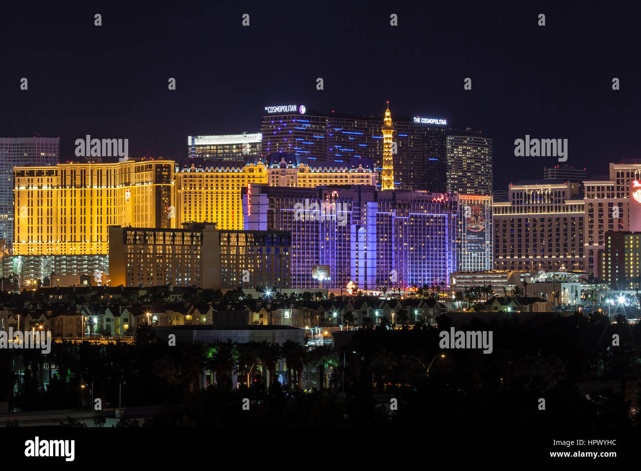 Editorial night view of Cosmopolitan, Ballys, Paris and other casino resorts on the Las Vegas strip. Stock Photo
