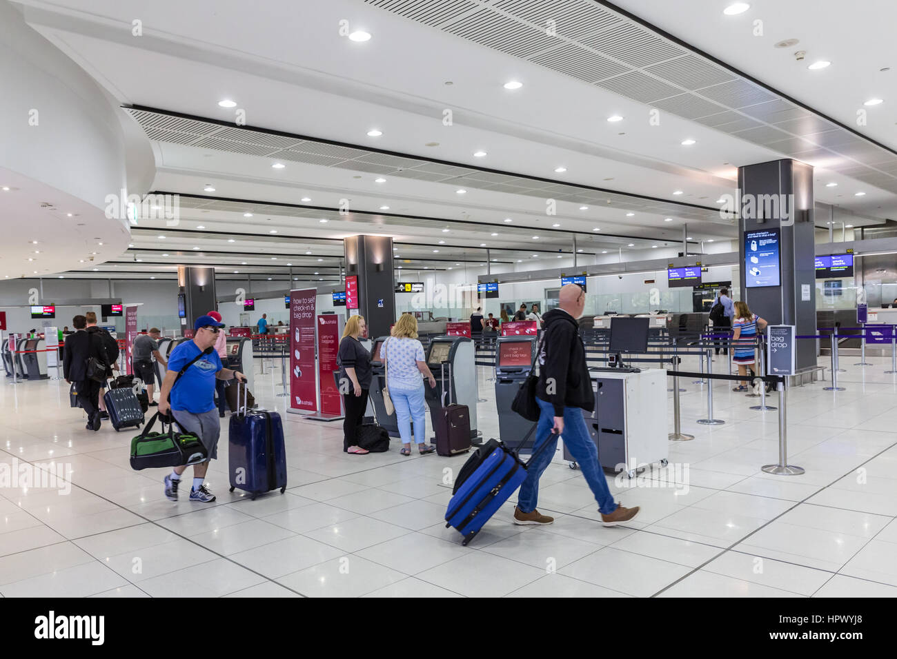 Passengers in departure hall at airport terminal - Stock Image