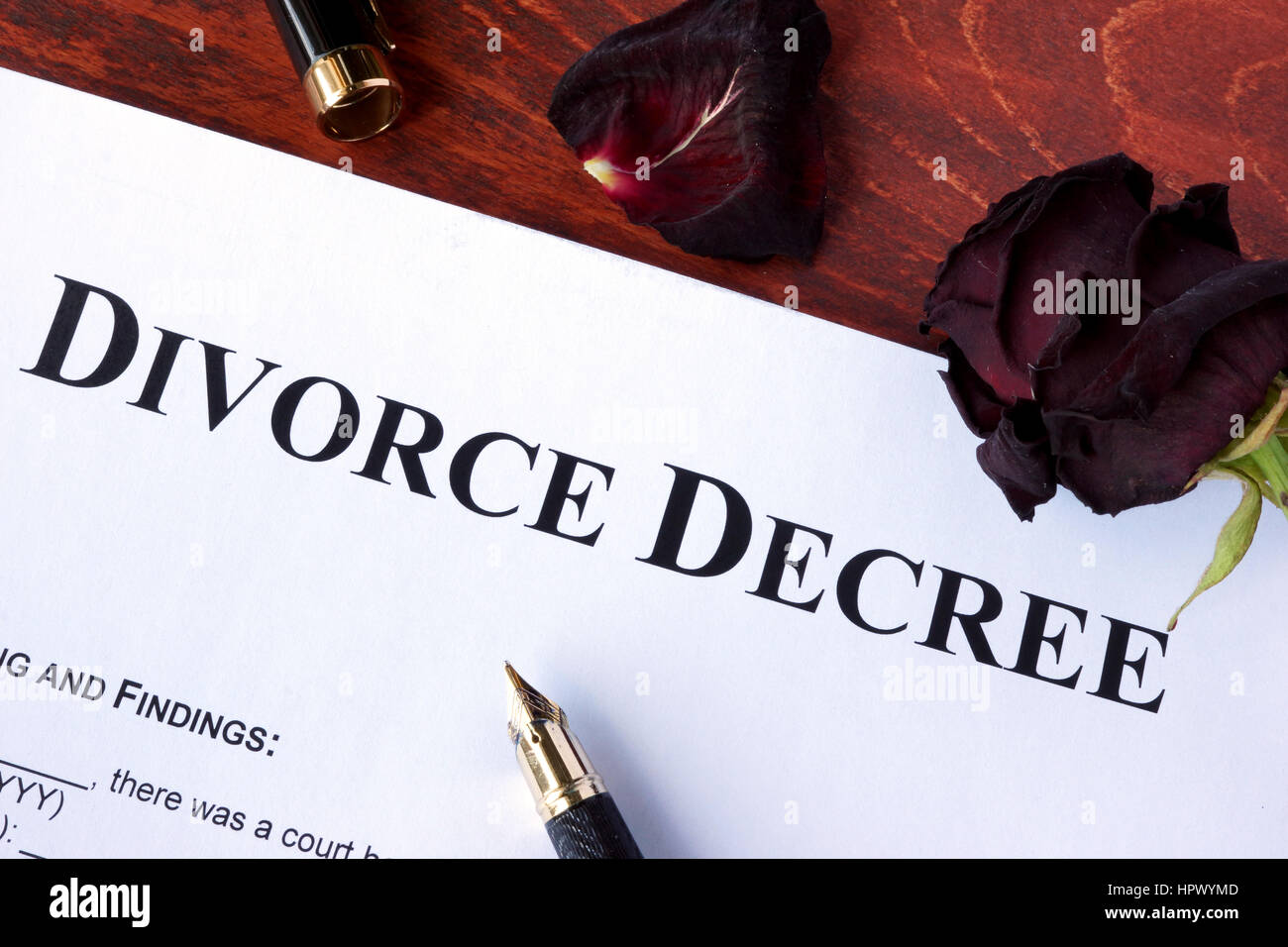 Divorce decree form and faded rose. Separation concept. - Stock Image