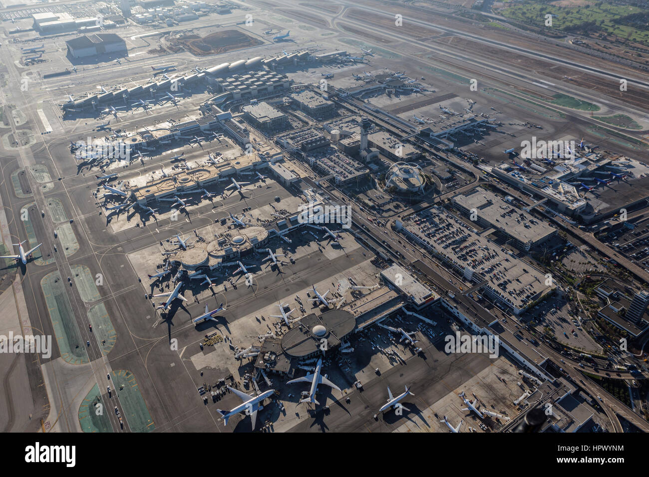 Los Angeles, California, USA - August 16, 2016:  Aerial view of the busy LAX terminals, control tower and parking - Stock Image