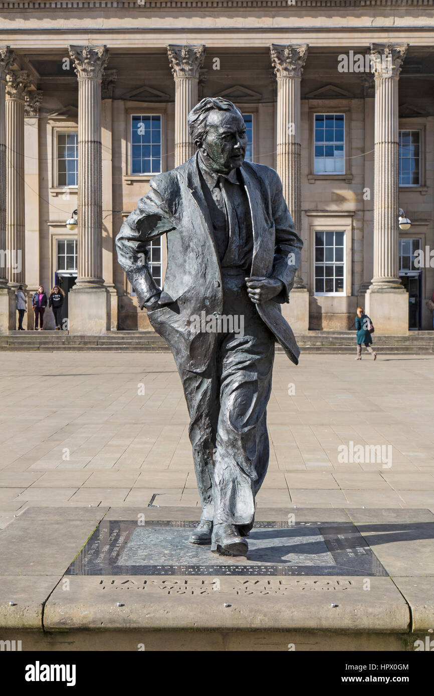 Statue of former British Prime Minister Harold Wilson, outside Huddersfield Railway Station in England. - Stock Image