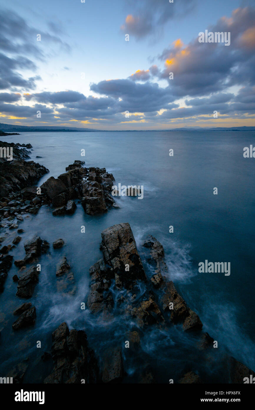 Helvick Pier Rocks - Stock Image