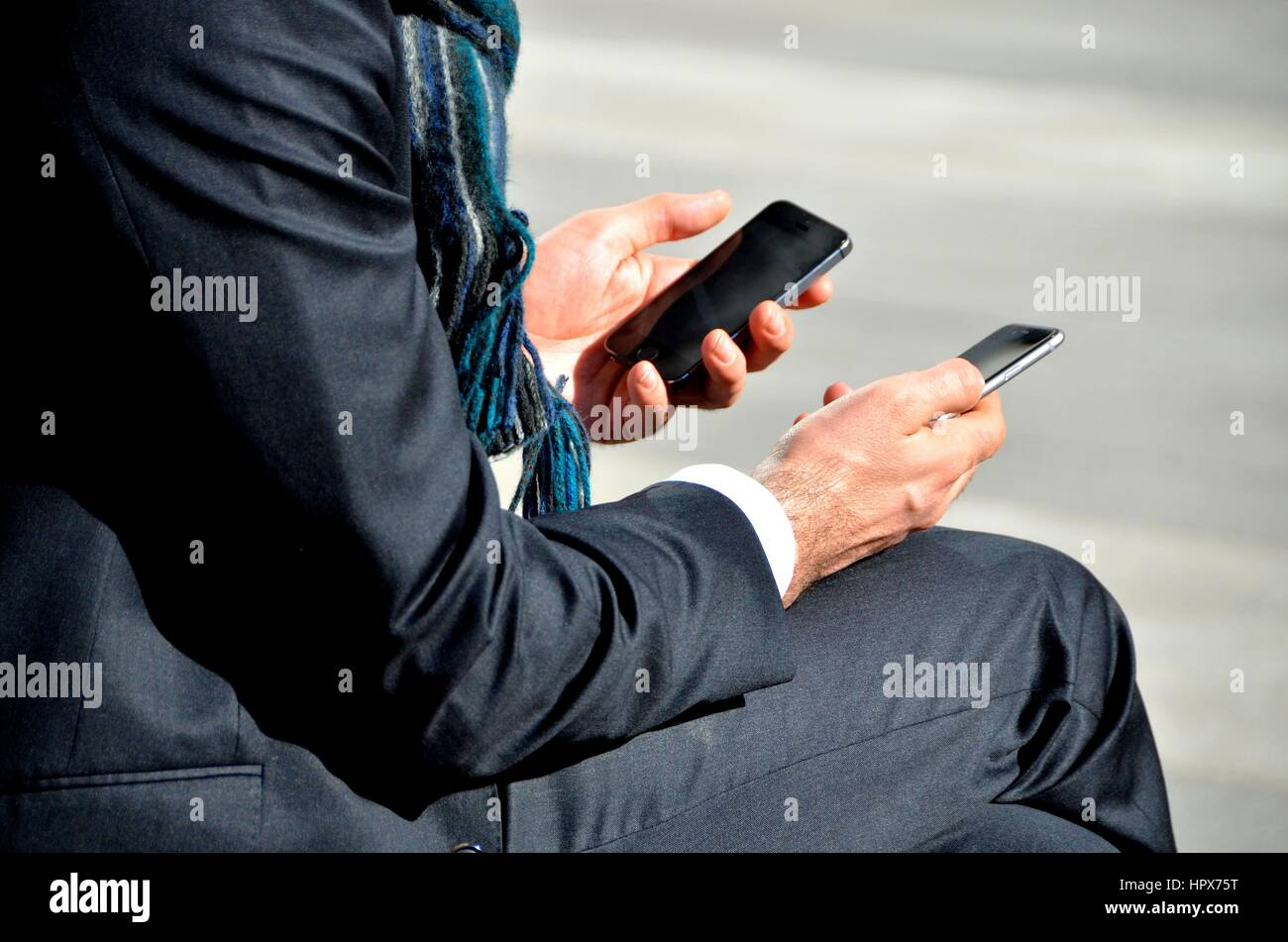 Using Two Cell Phones at same time. - Stock Image