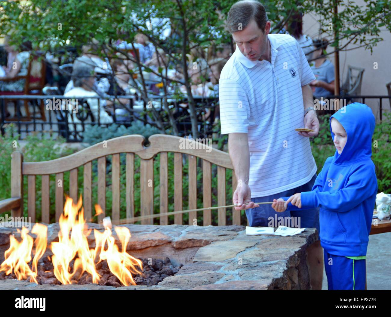 Unidentified people roasting Marshmallows. - Stock Image