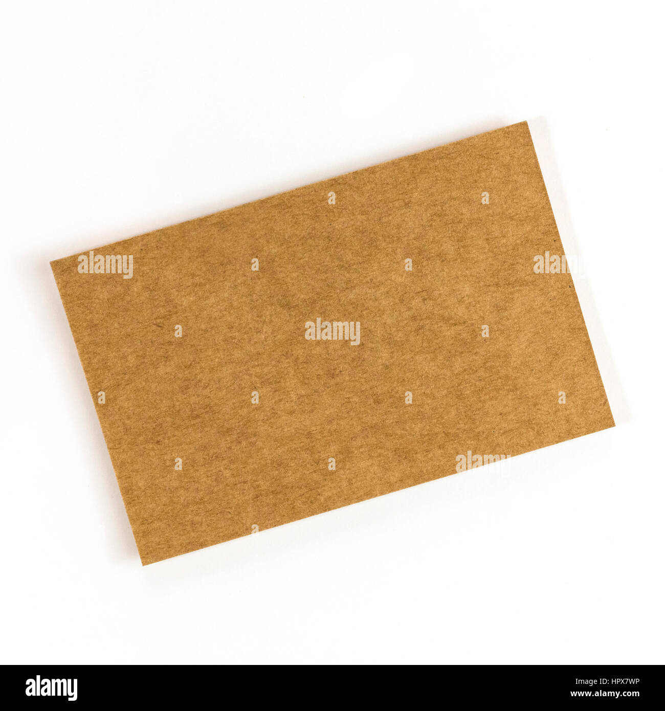A photo of a kraft paper business card on a white background a a photo of a kraft paper business card on a white background a mockup or a minimalist banner with copy space colourmoves