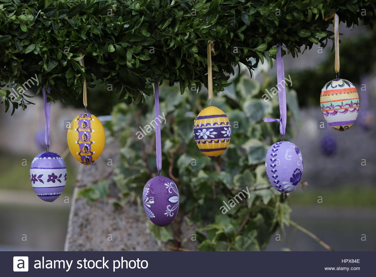 Handpainted Easter eggs hang from a fountain in a village in