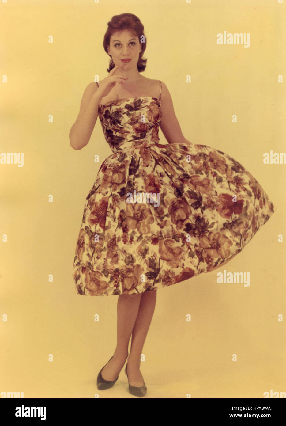 A Model Wearing A Summer Dress With Flowers Italy 1960 Stock Photo