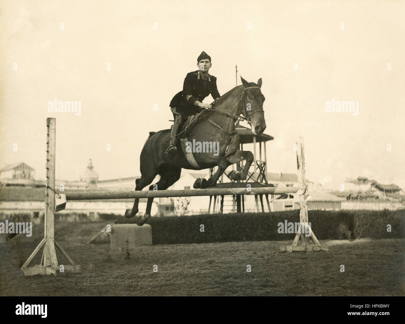 An Italian cavalry officer horsejumping - Stock Image