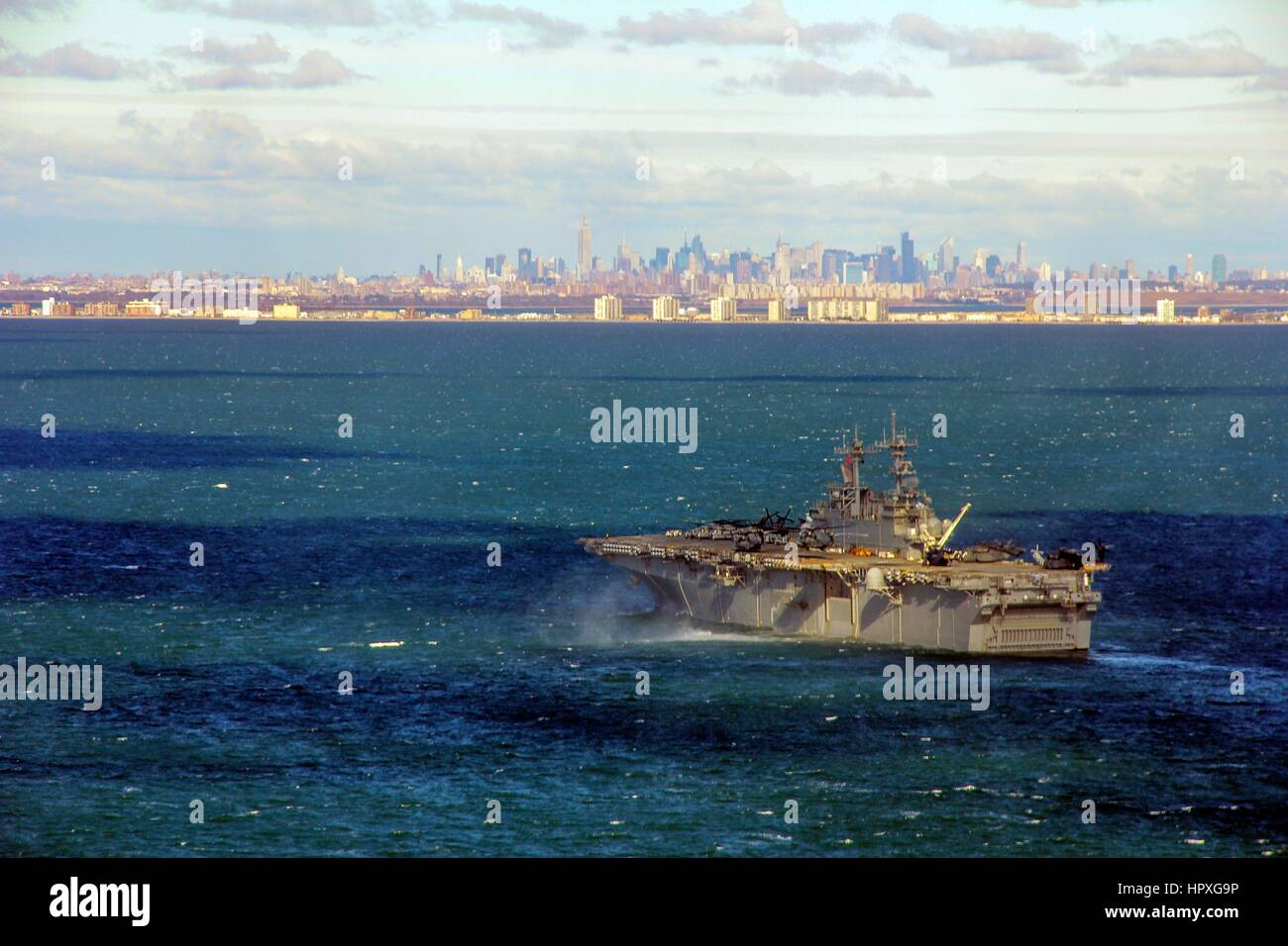 Amphibious assault ship USS Wasp (LHD 1) positioned near New York and New Jersey ready to assist NORTHCOM with disaster - Stock Image