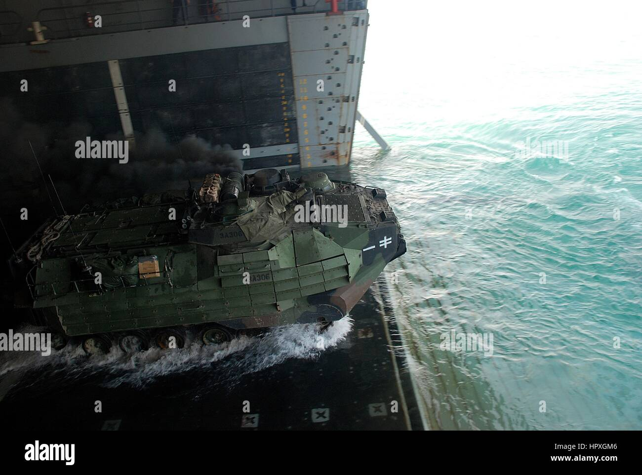An Amphibious Assault Vehicle departs the transport Dock Ship USS Green Bay during a routine well deck training Stock Photo