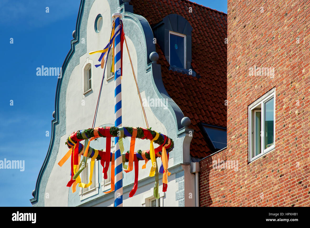 colorful may pole in town - Stock Image