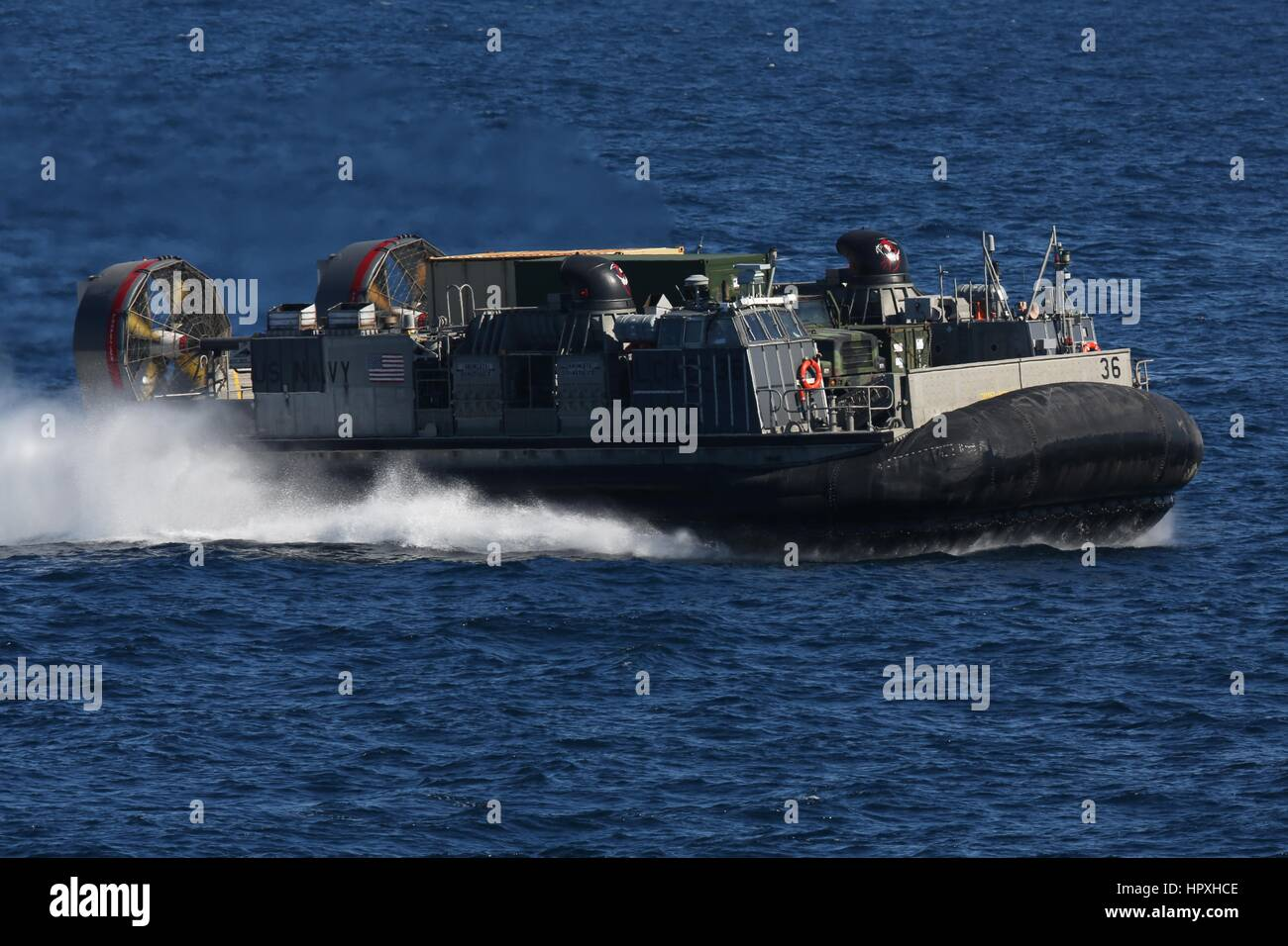 A landing craft air cushion from Assault Craft Unit 4 approaches the amphibious assault ship USS Kearsarge, January Stock Photo