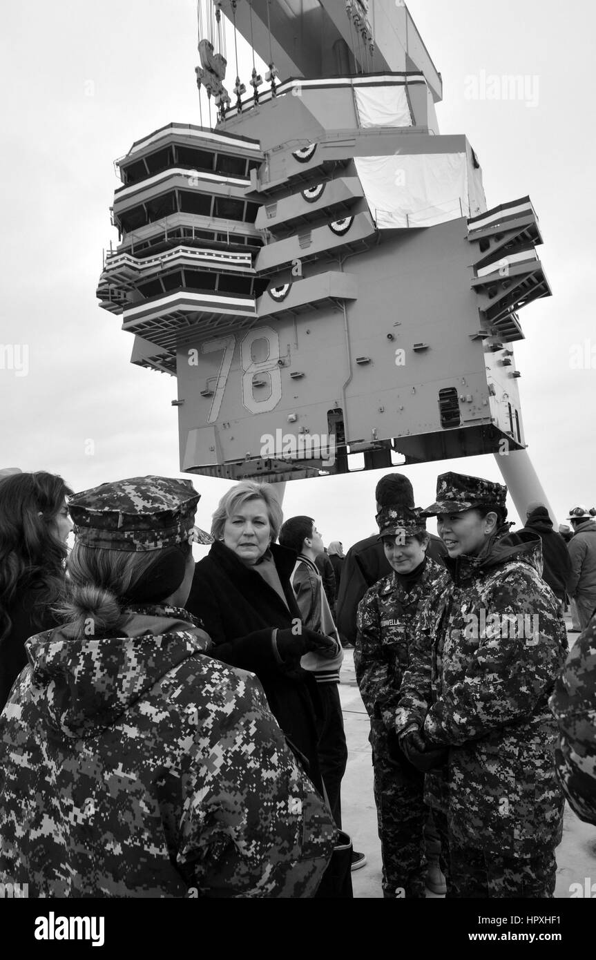 Susan Ford Bales, daughter of late President Gerald R. Ford, speaks with members of the future nuclear-powered aircraft - Stock Image
