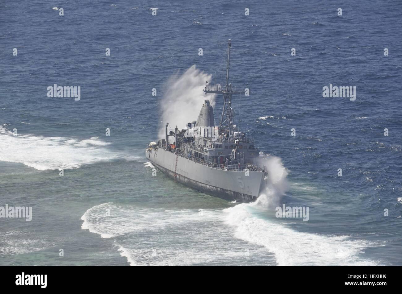 Heavy waves crash against the grounded mine countermeasure ship USS Guardian, January 29, 2013. Image courtesy US - Stock Image