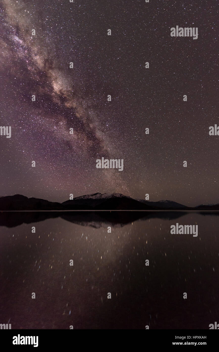 Night Scene, Wanaka lake with stars and Milky Way, stars mirroring in the water, Glendhu Bay, Otago, Southland, - Stock Image
