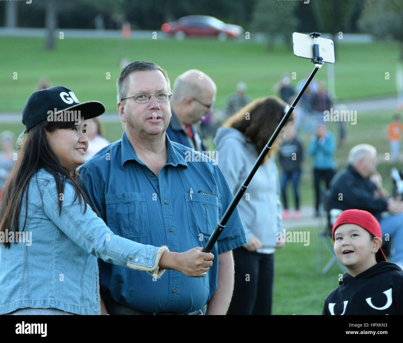 Unidentified people taking a Selfie picture - Stock Image