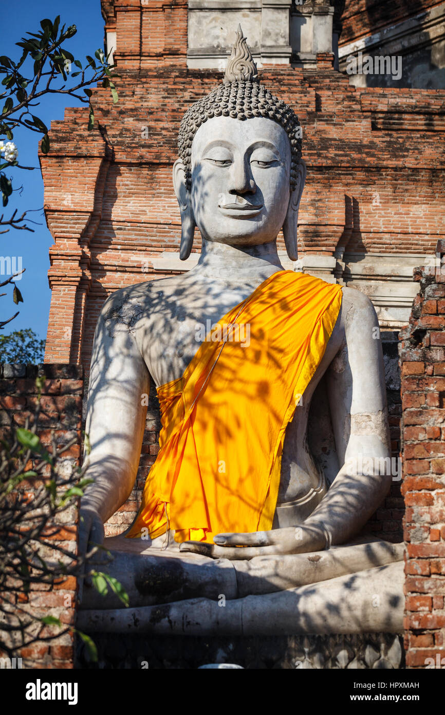 Big Buddha statue with yellow robe in Wat Yai Chai Mongkol monastery in Ayuttaya, Thailand - Stock Image