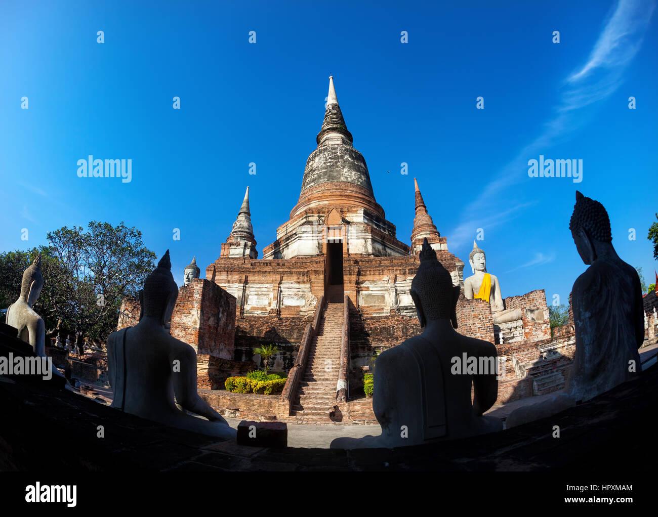 Big Stupa and Buddha statues in Wat Yai Chai Mongkol monastery in Ayuttaya, Thailand - Stock Image