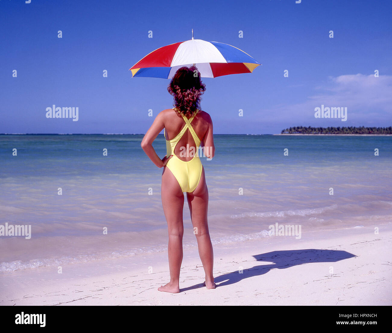 Young woman on tropical beach, Dominican Republic, Greater Antilles, Caribbean - Stock Image