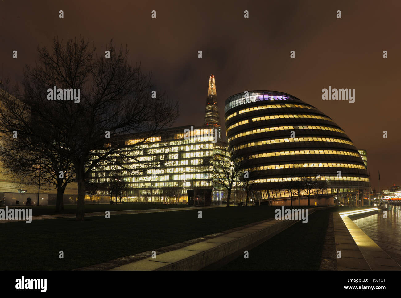 City Hall, South Bank, London on a wet night it is the headquarters of the Greater London Authority, the Mayor of - Stock Image