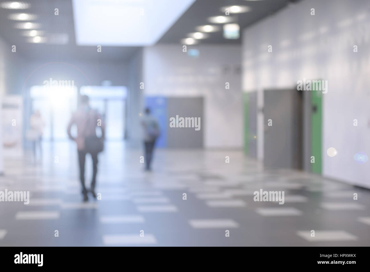 Corridor in a modern business center or a university hall - defocused with bokeh lights - Stock Image