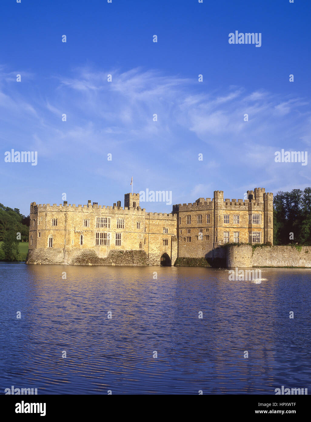View of Leeds Castle across moat, Broomfield, Kent, England, United Kingdom - Stock Image