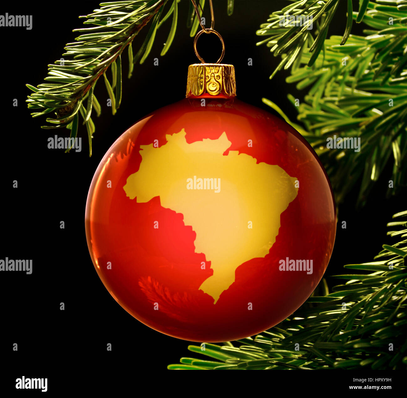 Christmas In Brazil.A Red Bauble With The Golden Shape Of Brazil Hanging On A