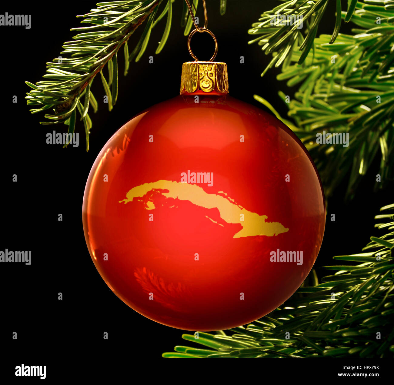 Christmas In Cuba.A Red Bauble With The Golden Shape Of Cuba Hanging On A