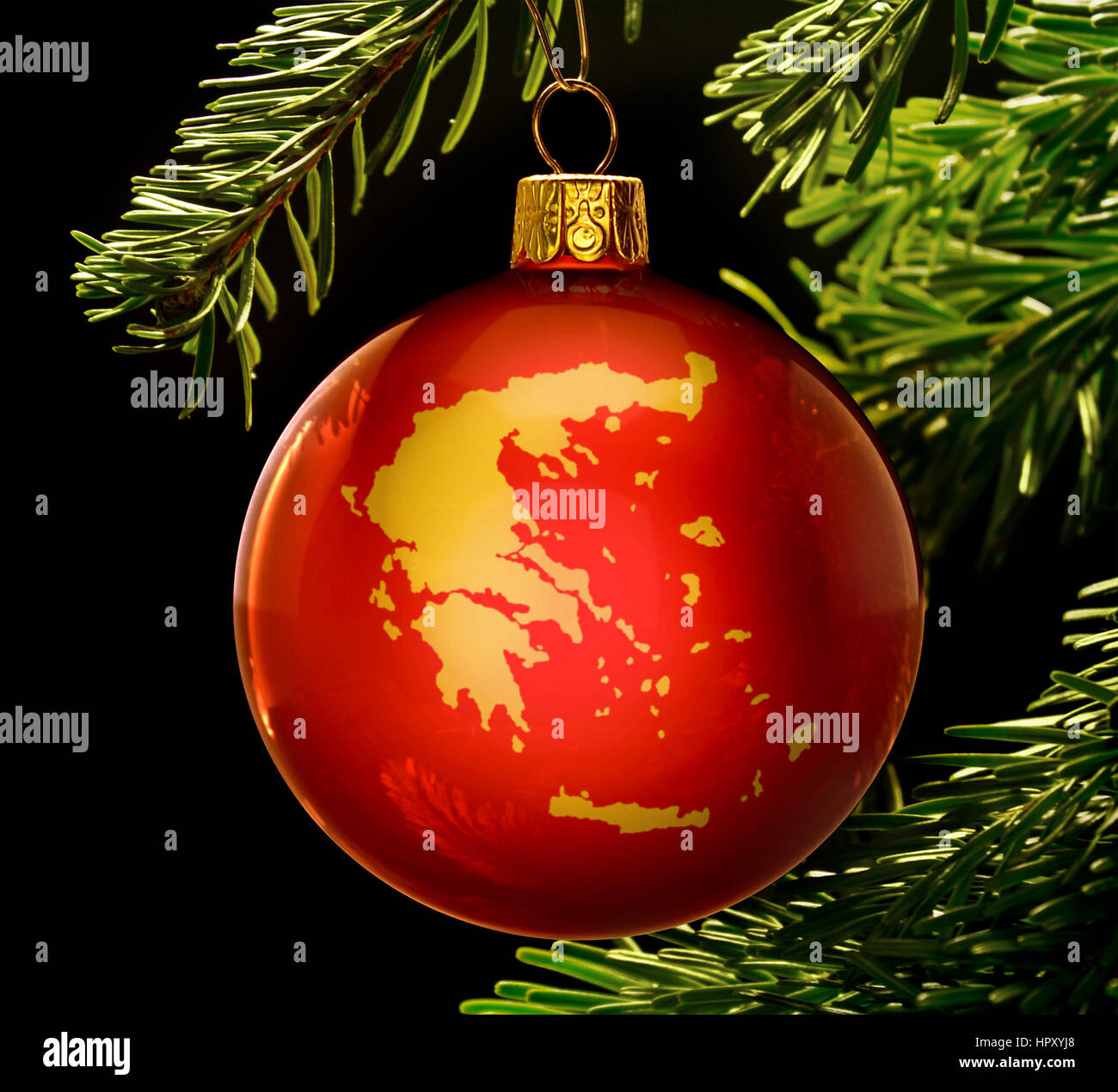 a red bauble with the golden shape of greece hanging on a christmas tree isolated on - Greek Christmas Decorations