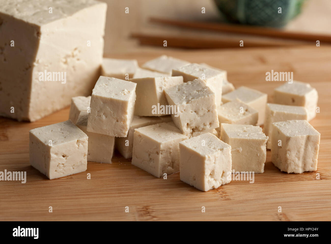 Fresh cut pieces of raw tofu - Stock Image