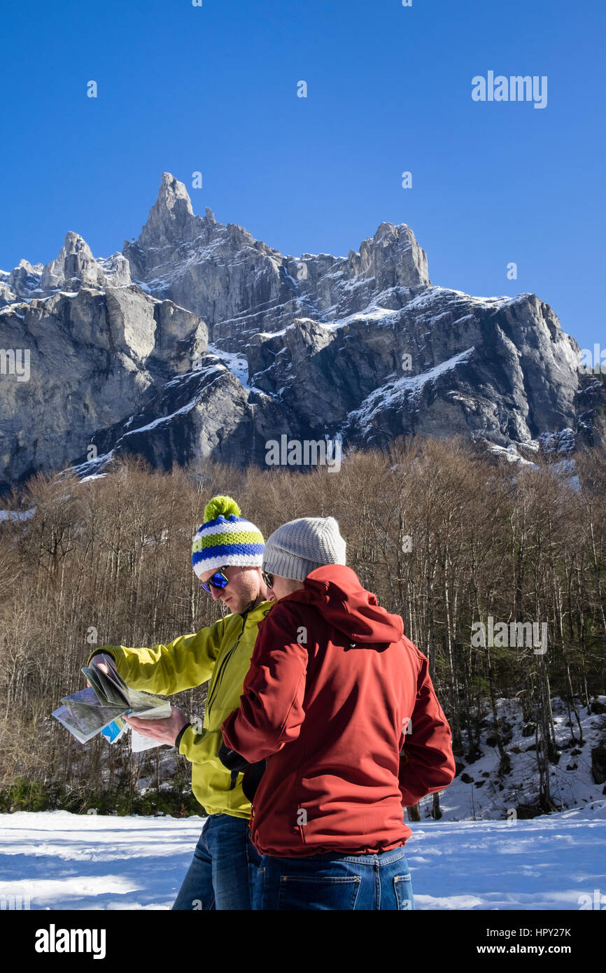 Walkers reading a map in Reserve Naturelle de Sixt Fer A Cheval below Pic de Tenneverge mountain in Le massif du - Stock Image