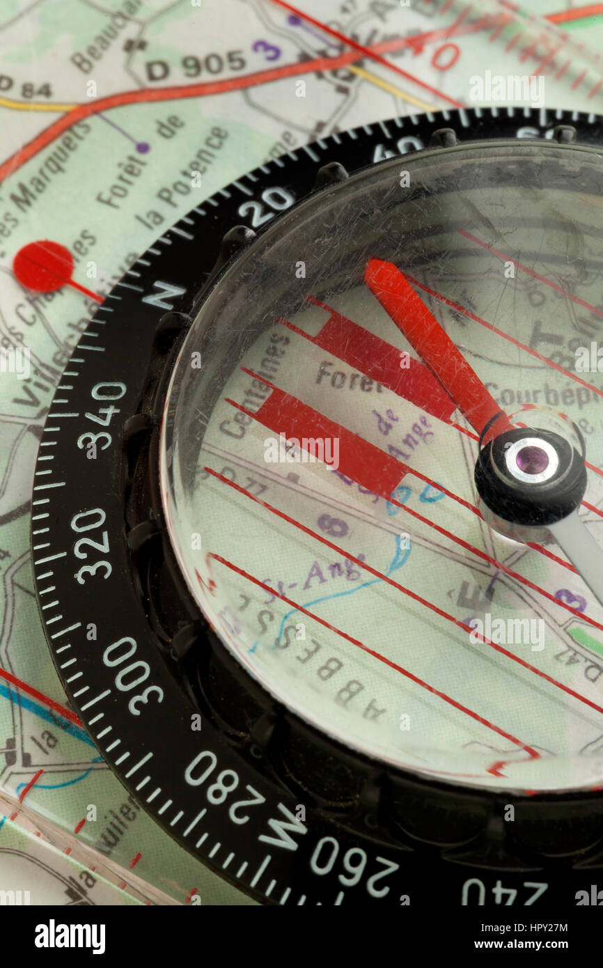 Compass on a map close up - Stock Image