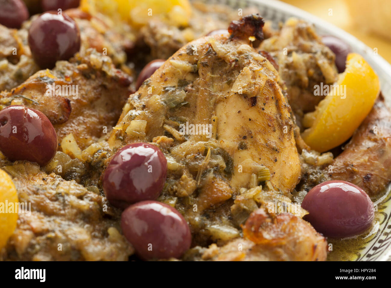 Moroccan dish with chicken, olives and preserved lemon close up - Stock Image