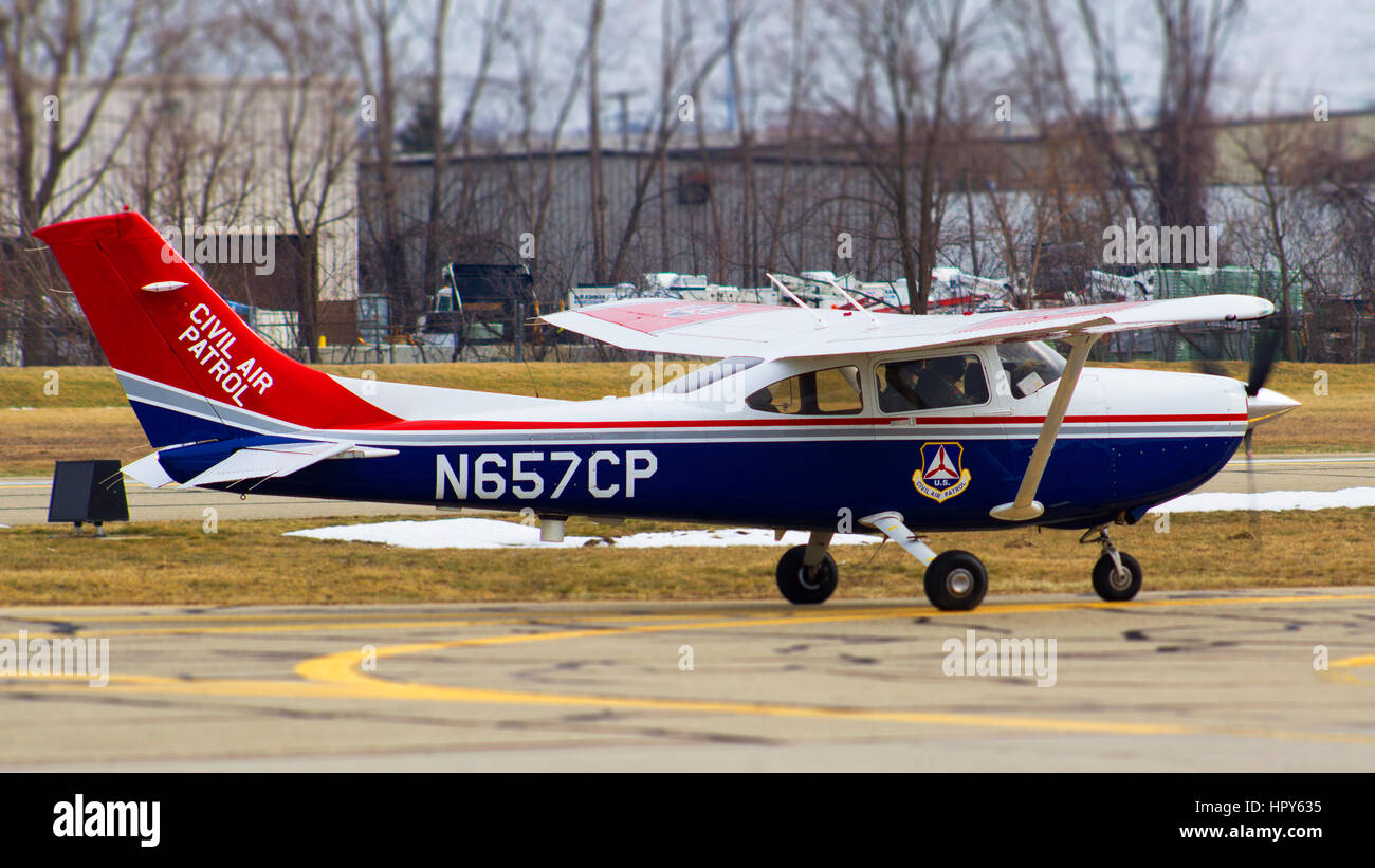 A  civil air patrol plane taxiing to the runway - Stock Image