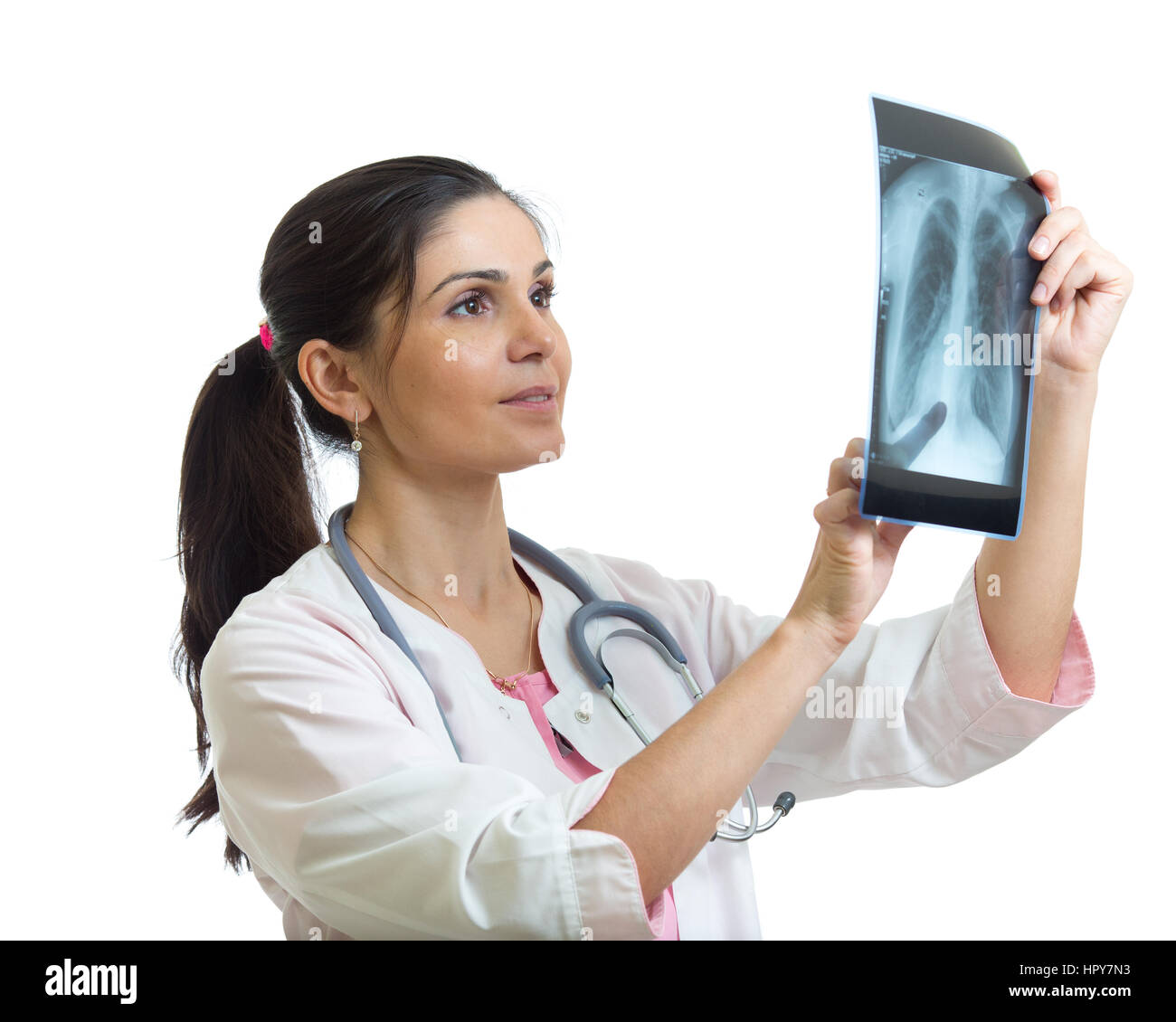Young female doctor looking at the x-ray picture of lungs. Isolated on white background. - Stock Image