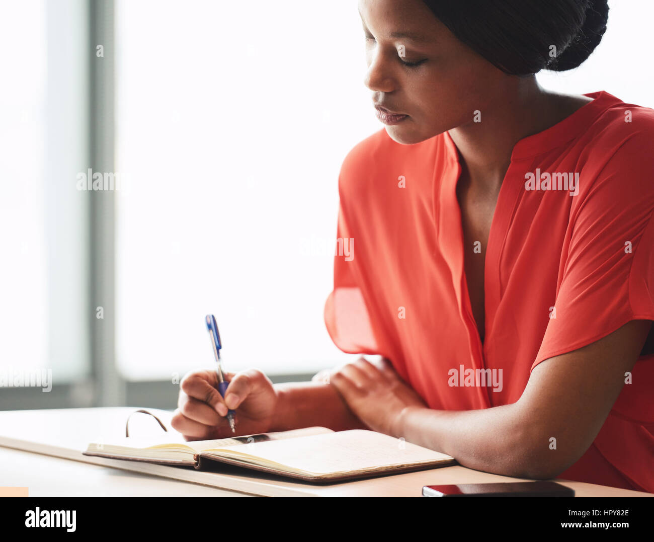 Beautiful young african american writer busy making hand