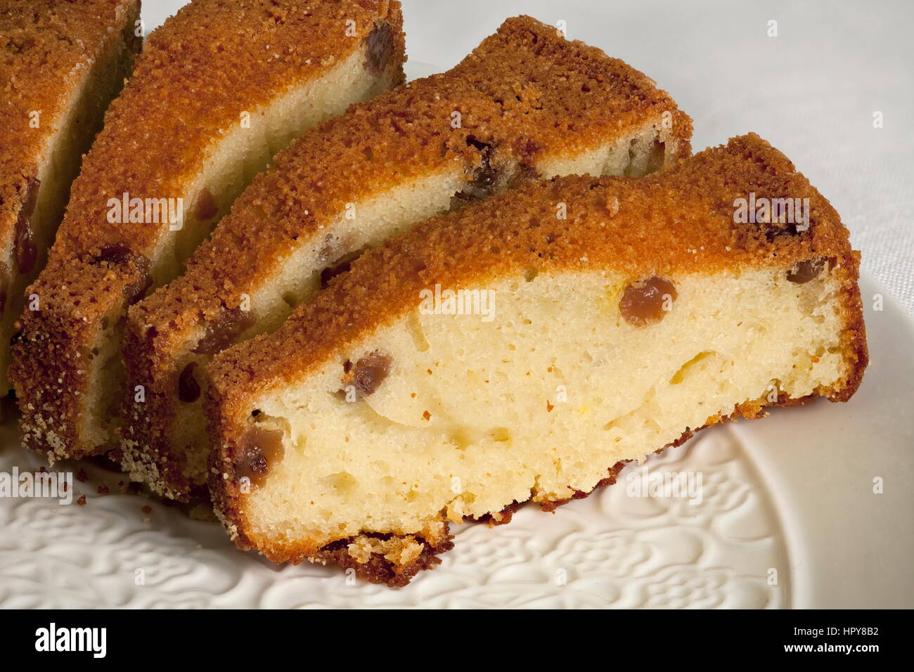 Curd cake with raisins and ruddy crust slices macro shot,creative cuisine, delicious pastry, tasty breakfast, - Stock Image