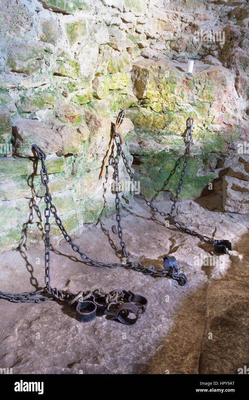 SPISSKY CASTLE, SLOVAKIA - JULY 19, 2014: The irons from oubliette the castle. - Stock Image